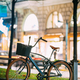 Bicycle Equipped Basket Parked In European City Street In Night - PhotoDune Item for Sale