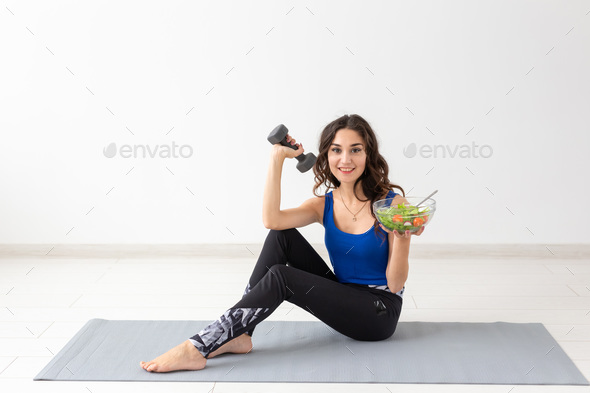 Healthy lifestyle, people and sport concept - Portrait of a healthy woman with vegetables and - Stock Photo - Images