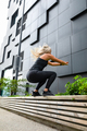 Hardworking fitness woman jumping outdoor in urban enviroment - PhotoDune Item for Sale