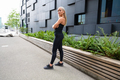 Confident Female Urban Runner Standing With Her Arms Crossed - PhotoDune Item for Sale