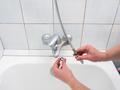 Plumber uninstalling faucet - PhotoDune Item for Sale