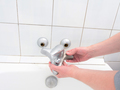 Plumber holding a dual outlet shower faucet - PhotoDune Item for Sale