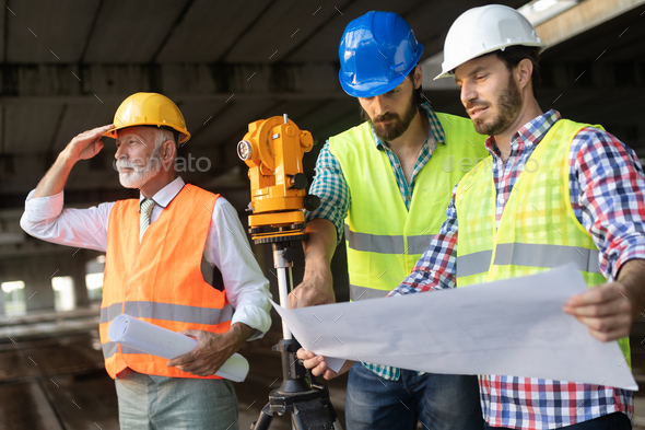 Construction engineer with foreman worker checking construction site - Stock Photo - Images
