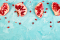 Half pomegranate fruit on blue background. Fresh red ripe - PhotoDune Item for Sale
