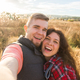 Travel, vacation and holiday concept - Happy couple having fun taking selfie against background on - PhotoDune Item for Sale