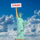 Strike in USA concept. Statue of Liberty and sign with space for - PhotoDune Item for Sale