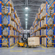Forklift truck in warehouse or storage and shelves with cardboar - PhotoDune Item for Sale
