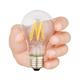 Hand holding LED bulb isolated - PhotoDune Item for Sale