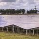 Solar panel field in industrial area close up on summer day - PhotoDune Item for Sale