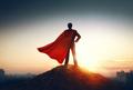 superhero businessman looking at city - PhotoDune Item for Sale