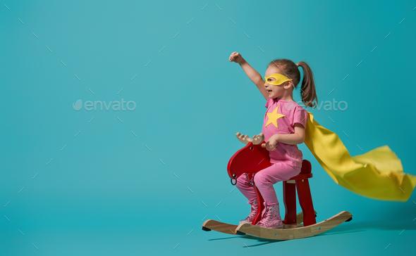 child playing superhero - Stock Photo - Images