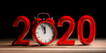 New year 2020 eve, red digits and alarm clock on wooden desk, black background. 3d illustration - PhotoDune Item for Sale