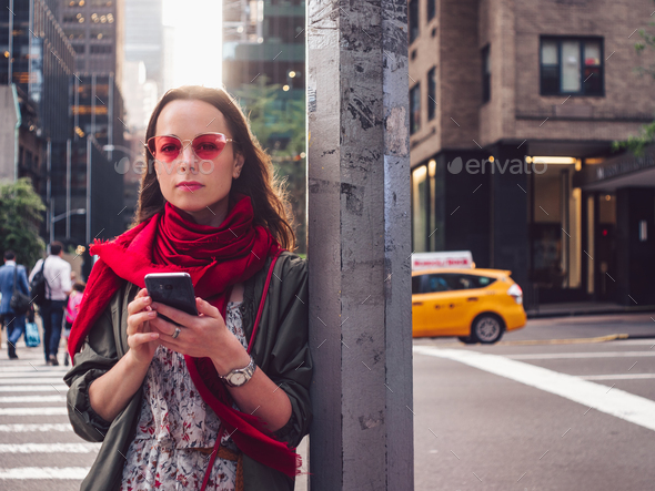 Attractive woman with a phone - Stock Photo - Images