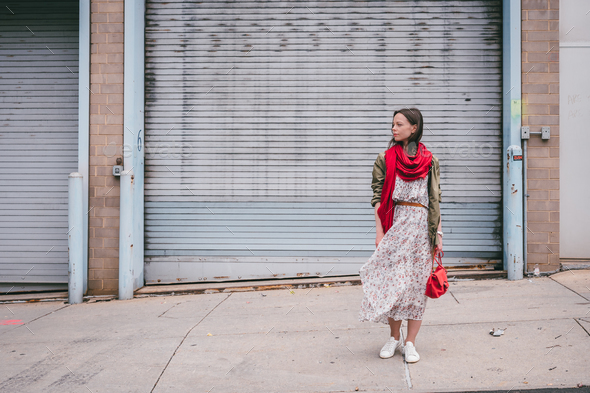 Attractive girl with a red scarf on the street - Stock Photo - Images