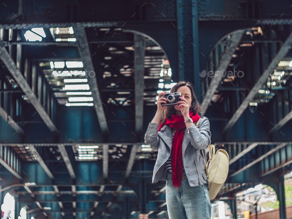 Young woman with a retro photo camera - Stock Photo - Images