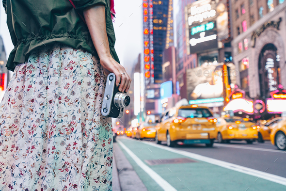 Young girl with a retro camera in New York City - Stock Photo - Images