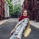Smiling girl with a red scarf in New York - PhotoDune Item for Sale