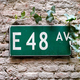 Road sign with E 48 av on green background - PhotoDune Item for Sale