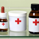 Medicine jars with red cross sign - PhotoDune Item for Sale