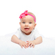 happy beautiful baby girl with pink flower on head - PhotoDune Item for Sale