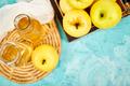 Glass Bottle of apple organic vinegar on blue background. - PhotoDune Item for Sale