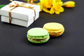 Bouquet flowers narcissus gift and sweets or cake macarons. - PhotoDune Item for Sale
