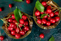 Red cherry in bowl on green background. Summer or spring concept. - PhotoDune Item for Sale