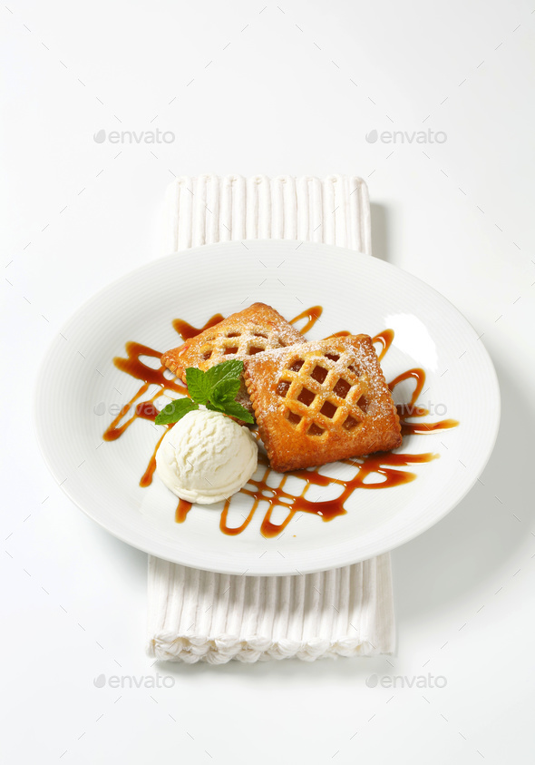 Little apricot pies with ice cream - Stock Photo - Images