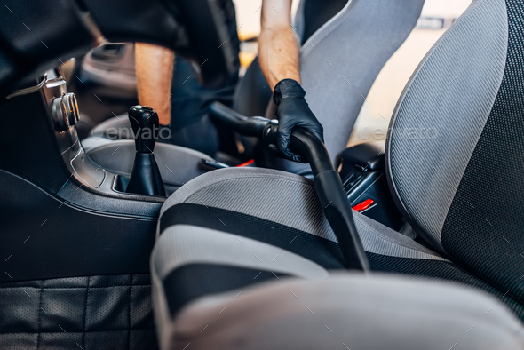 Auto detailing, cleaning seats with vacuum cleaner - Stock Photo - Images