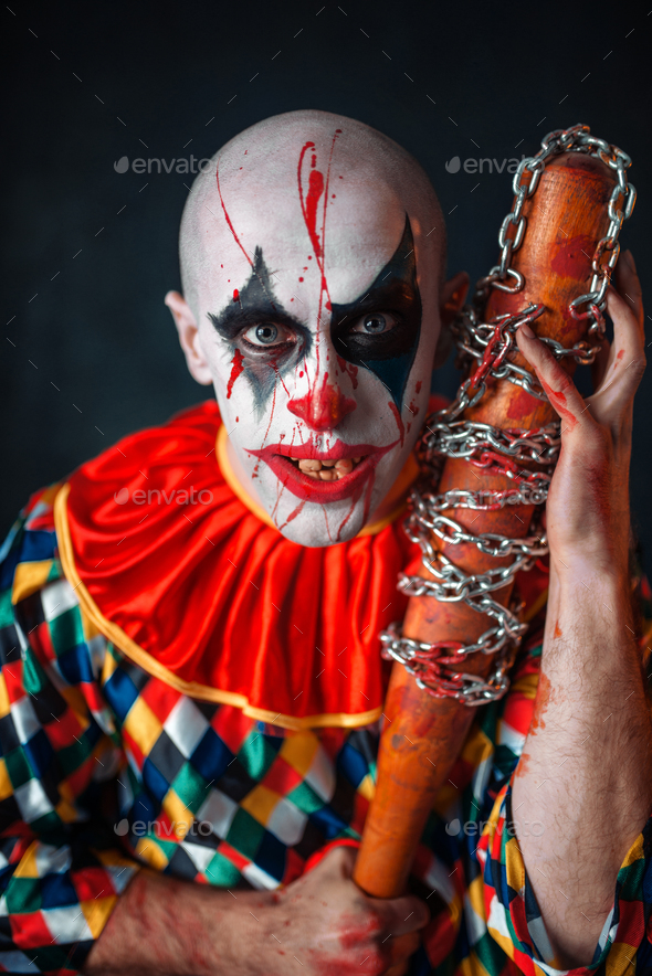 Crazy bloody clown with baseball bat - Stock Photo - Images