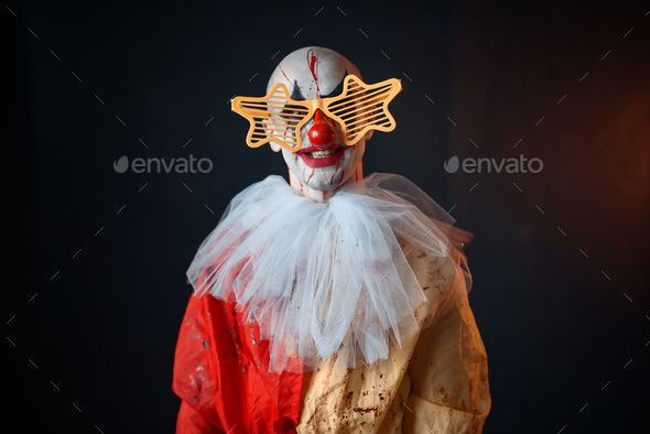 Mad clown in carnival costume and holiday glasses - Stock Photo - Images