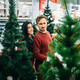Couple buying christmas tree in supermarket - PhotoDune Item for Sale