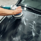 Male person with polishing machine cleans car hood - PhotoDune Item for Sale
