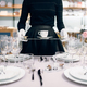 Waitress with tray puts the dishes, table setting - PhotoDune Item for Sale