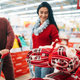 Couple buying christmas costume in supermarket - PhotoDune Item for Sale