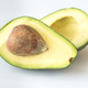 Halved avocado on the white background - PhotoDune Item for Sale