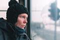 Sad woman on the bus looking through window - PhotoDune Item for Sale