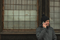 Serious woman talking on mobile phone on street in winter - PhotoDune Item for Sale