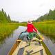 Paddling Through a Grassy Lake - PhotoDune Item for Sale