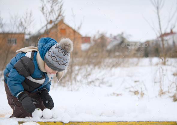 playing with snowball maker - Stock Photo - Images