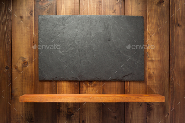 slate stone at wooden background - Stock Photo - Images