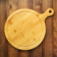 cutting board on wooden background table - PhotoDune Item for Sale