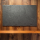 slate stone at wooden background - PhotoDune Item for Sale