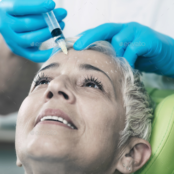 Anti-Aging Injections. Senior Woman Receiving Botulinum Toxin In - Stock Photo - Images