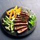 Beef steak with potato wedges and cucumber salad - PhotoDune Item for Sale