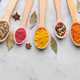 Colourful spices in wooden spoons on grey background - PhotoDune Item for Sale