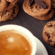 Homemade chocolate chip cookies and a cup of coffee on dark old wooden table - PhotoDune Item for Sale