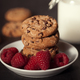 Chocolate chip cookies on white plate dark old wooden table with red raspberry and milk - PhotoDune Item for Sale