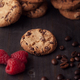 Chocolate chips cookies with red raspberries and coffee beans on dark old wooden table - PhotoDune Item for Sale