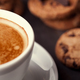 Coffee cup with chocolate cookies on dark old wooden table - PhotoDune Item for Sale